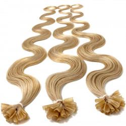 Rajouts cheveux bouclés