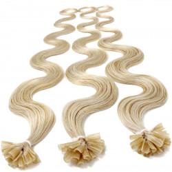 Extensions à chaud blond platine cheveux bouclés 63 cm